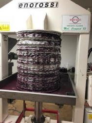 Mats loaded with olive paste ready for pressing - Used Enorossi Compact 80 Olive Press