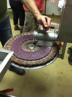 Loading the olive cake - Used Enorossi Compact 80 Olive Press